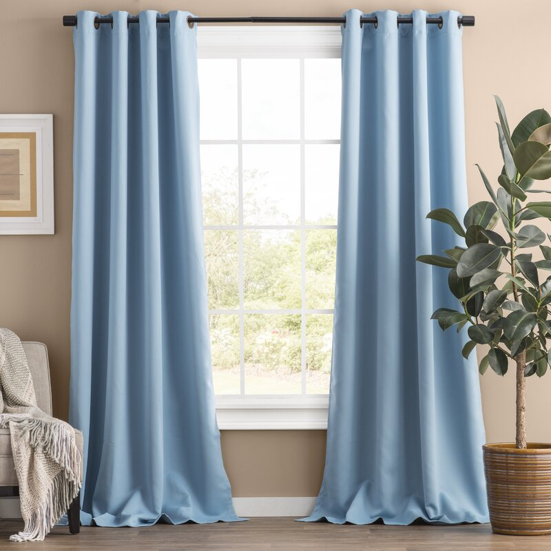 Blue color curtains for purple wall