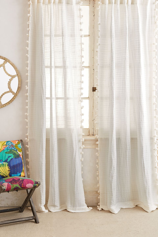 Cream color curtains for orange walls
