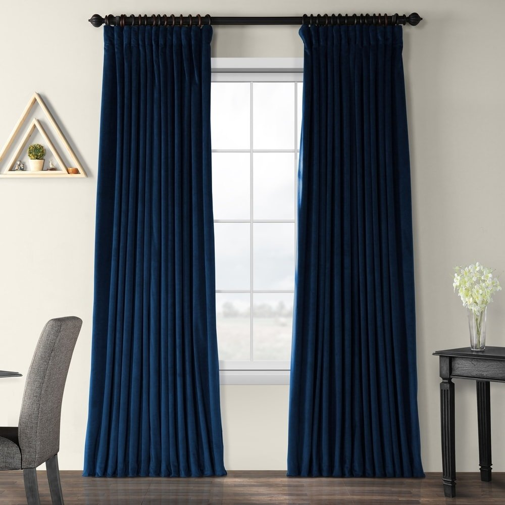Intense blue curtain with orange-toned wood wall