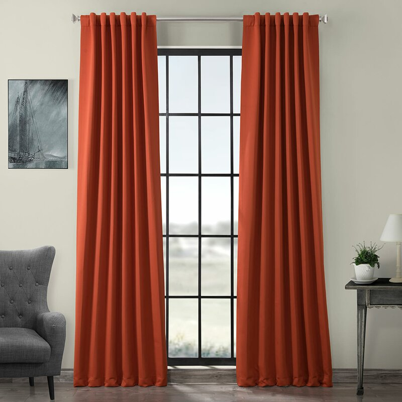 Orange color curtains for wooden wall