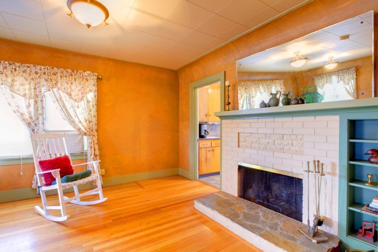 Room with orange walls and curtains
