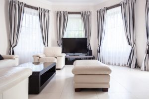 White Living Room With White and Black Curtains