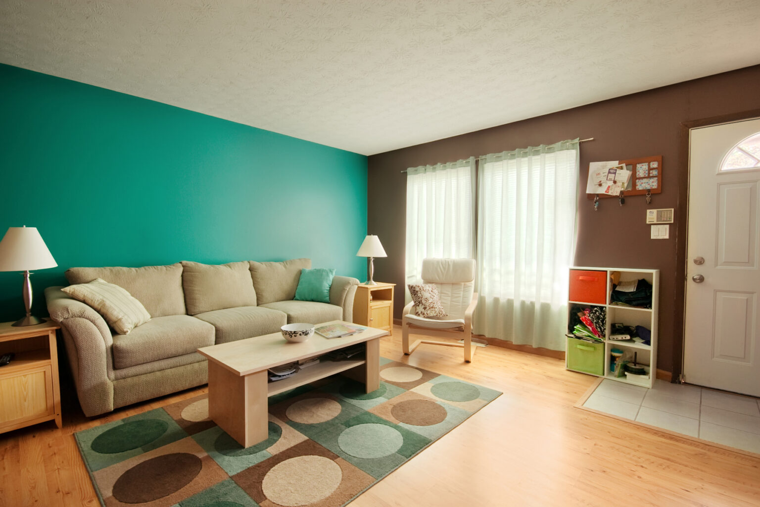 Living Room with Teal Walls and white curtains