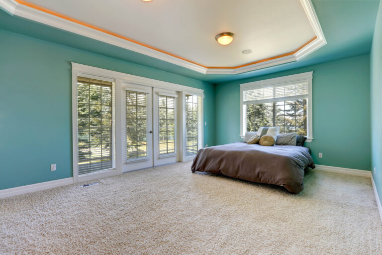 bedroom with turquoise color and white curtains